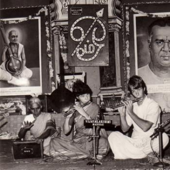 Street musicians in India playing flute