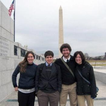 Four people at the Washington monument