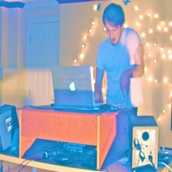Charles performs with a computer and bright lights
