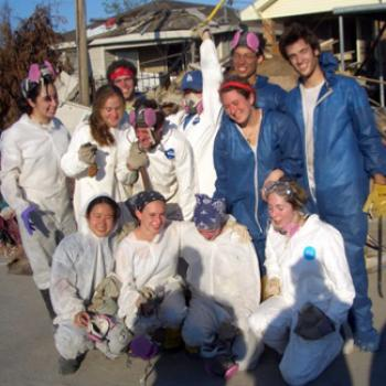 Group of volunteers in jumpsuits and protective gear