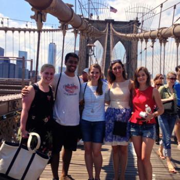 Ellen and friends on the walkway of an urban bridge