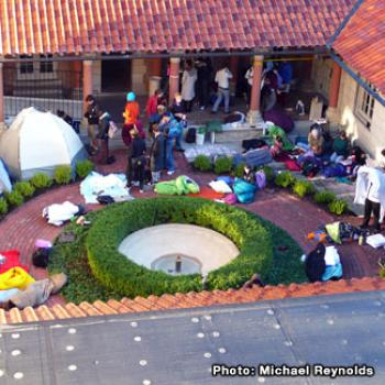 Students wait outside the museum, some in tents and sleeping bags.