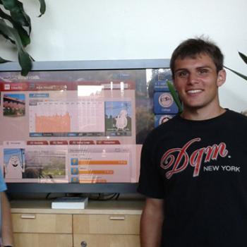 Evan beside a video monitor showing environmental data