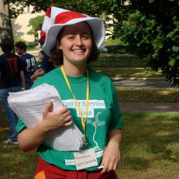 Francesca hand out information while wearing a Day of Service 2008 tee shirt