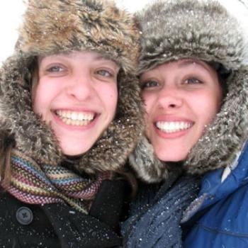Two friends in Russian-style fur hats