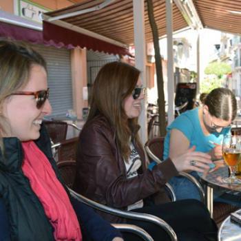 Hannah seated at an outdoor café