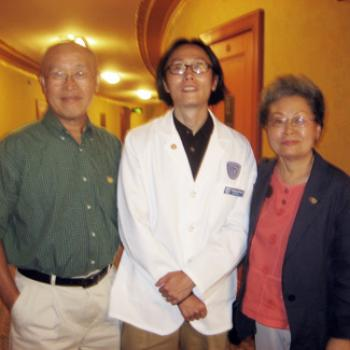 Three people, one wearing a lab coat
