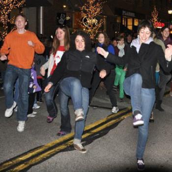 Group of people line dancing