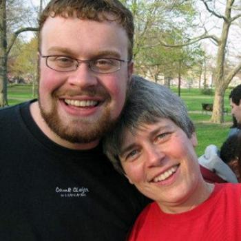 Jeffrey and Prof. Colton pose together with warm smiles