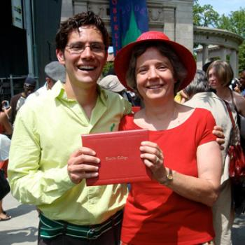 Jill and her son hold up an Oberlin College degree