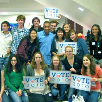 Group of students, several holding signs that say Vote 2010