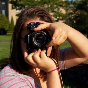 Ma'ayan adjusts the focus on a camera.