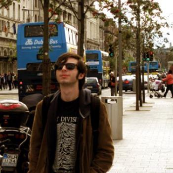 Mack walks along a city street.