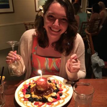 Megan's elegant dessert has a lit candle at the center.