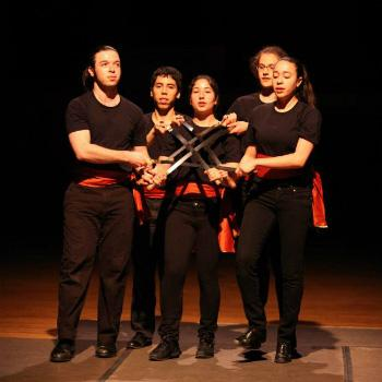 Five performers together on stage.
