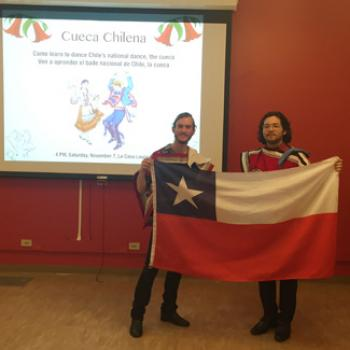 Two people hold up the flag of Chile