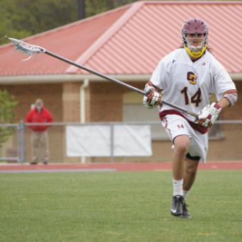Noel playing lacrosse.