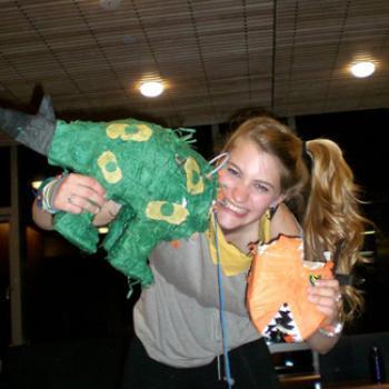 Phoebe shows off a broken piñata.