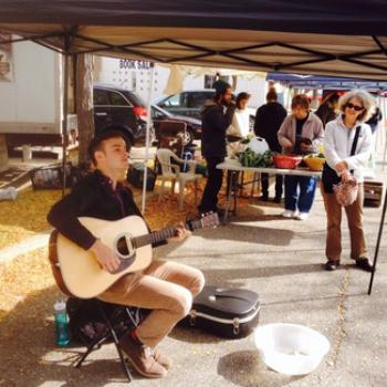 Rob plays acoustic guitar at the Oberlin Farmers' Market.