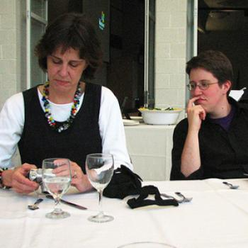 Ryan at a dinner table with Barbara Sawhill.