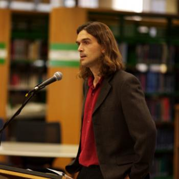 Professor Faber addresses a group.
