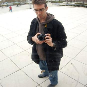 Steve holds a camera.