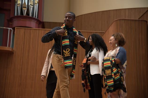 A student leaving the stage in Warner Concert Hall.