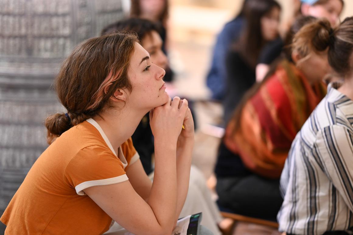 A student listens to a presentation.
