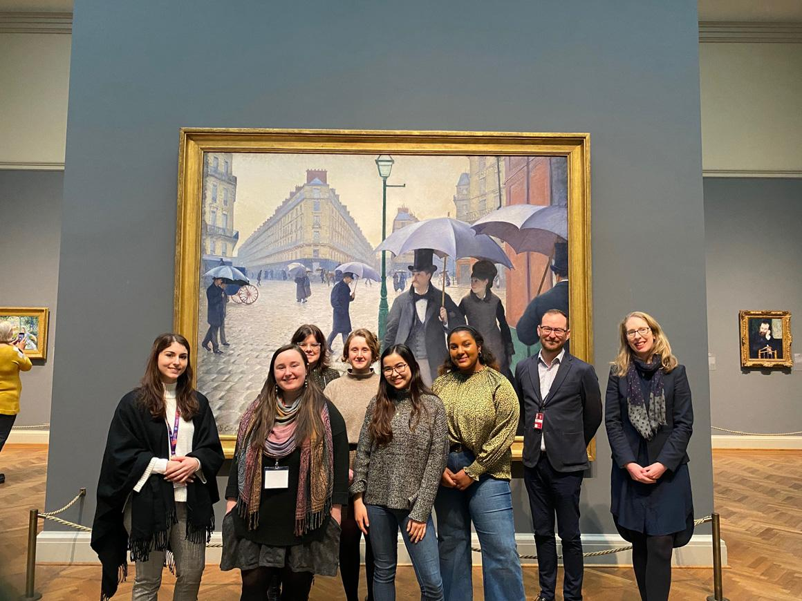 A group of students in front of a painting in a museum.