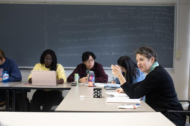 Professor Renee Romano and students in class.