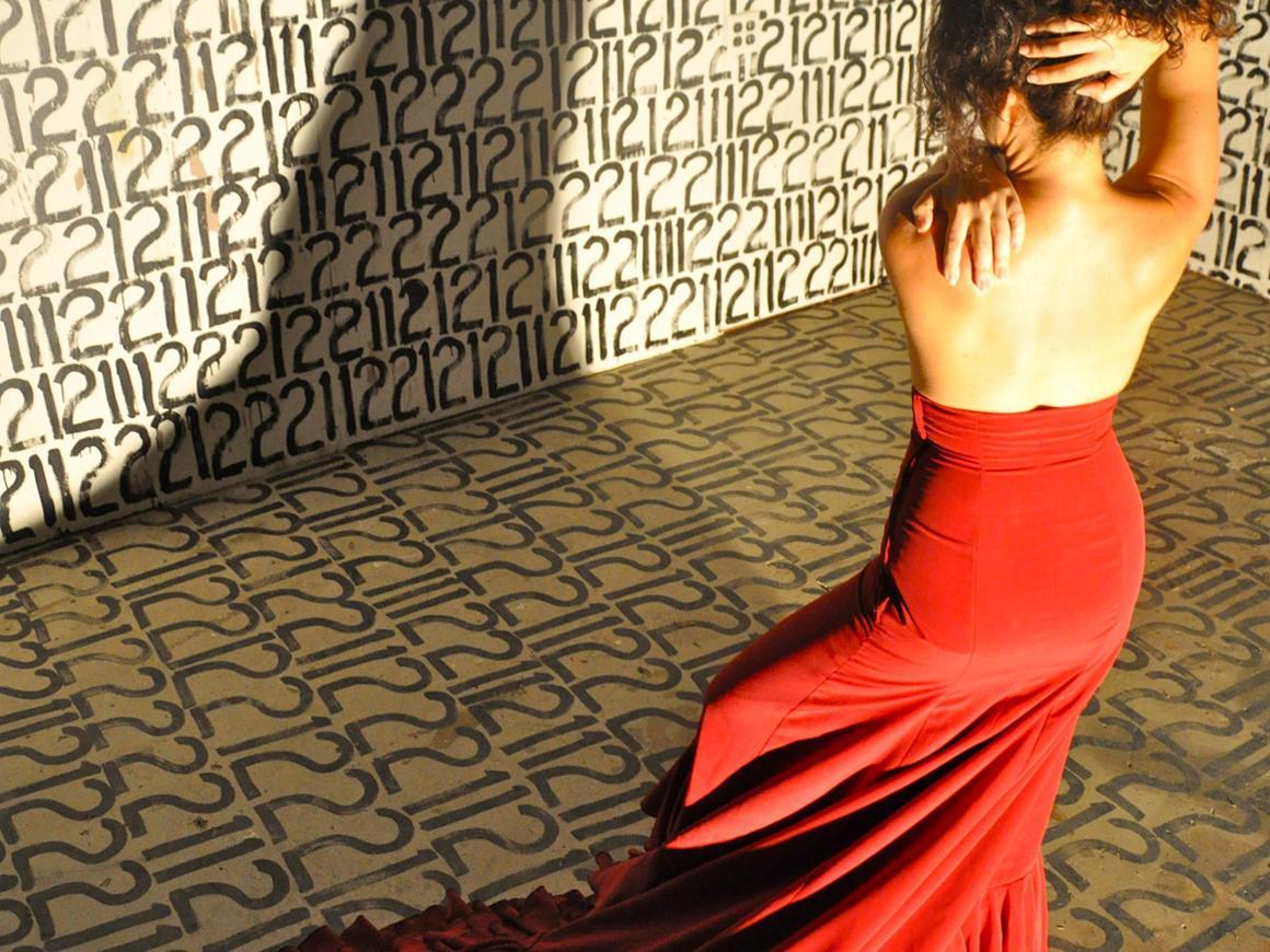 A flamenco dancer in a red dress