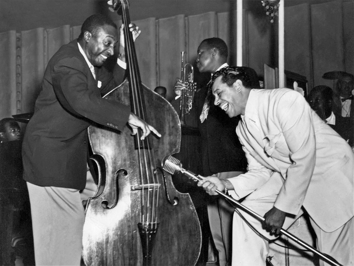 Cab Calloway leans his microphone toward Milt Hinton's bass
