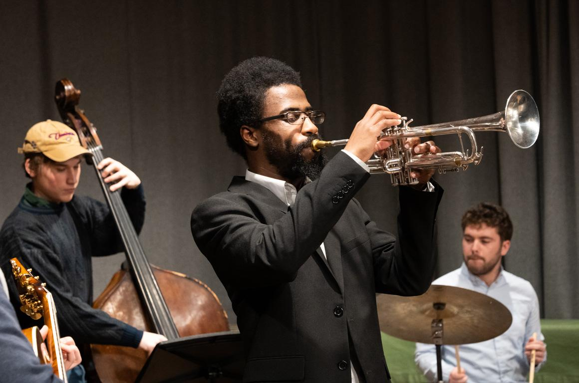 A small jazz combo with trumpet, bass, and drums.