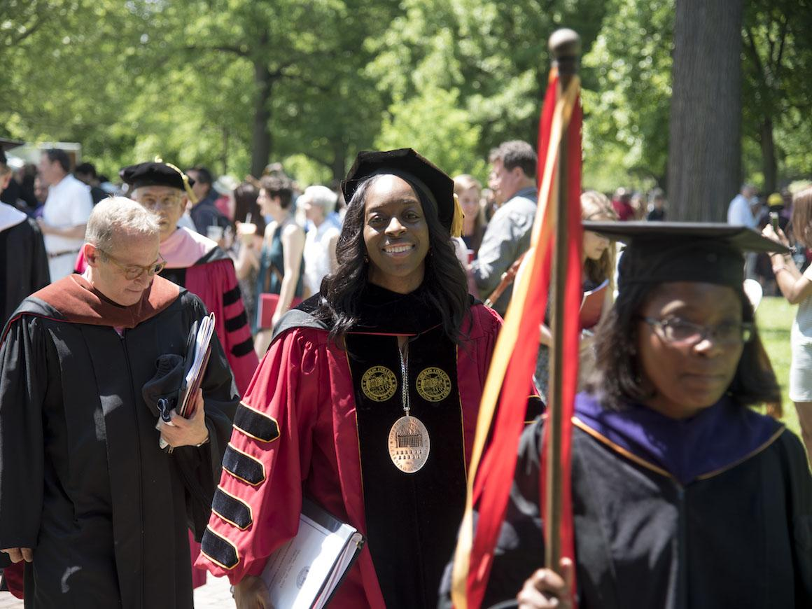oberlin president dressed in regalia walking in a processional.