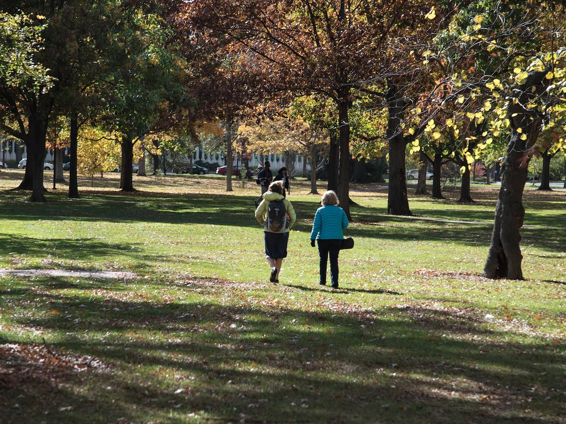 mother and son walking across Tappan Square.