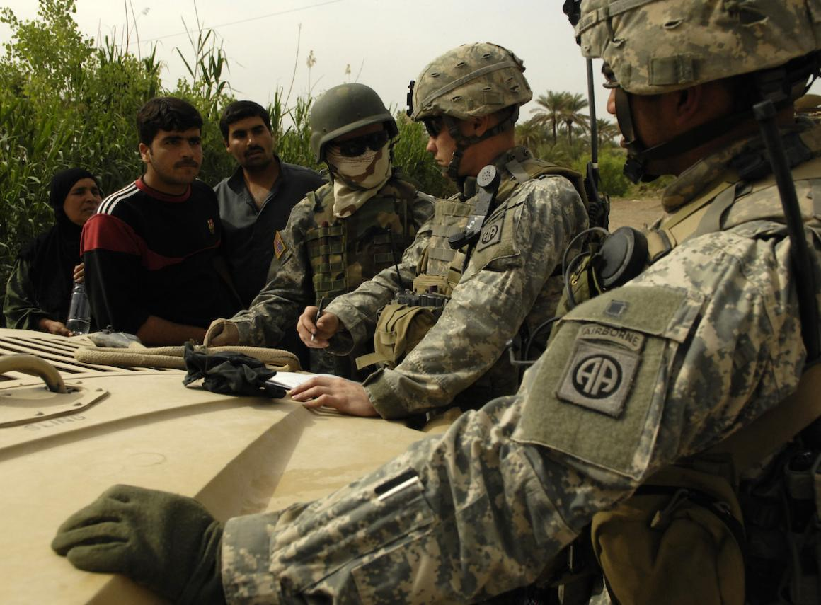 U.S. Army Soldiers conduct tactical questioning of locals during a presence patrol in As Sadah, Iraq, April 7, 2007.