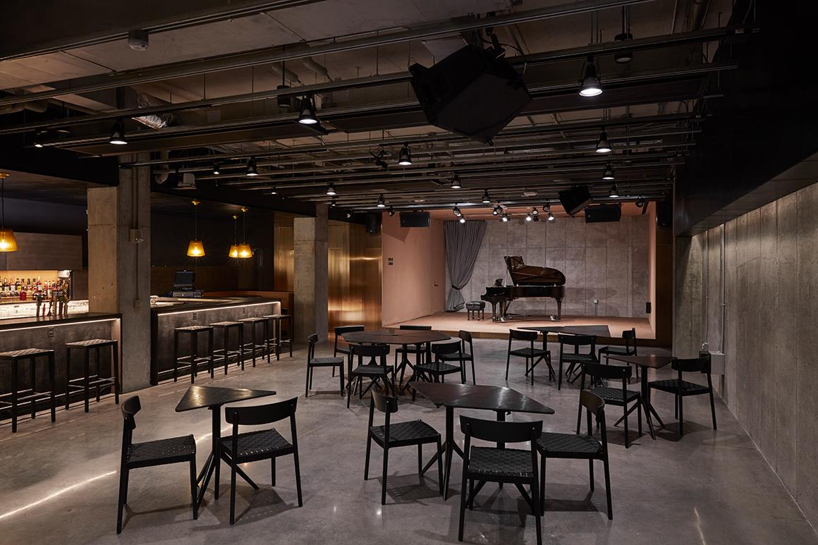 Interior of Birenbaum Innovation and Performance Space with cocktail tables and a stage