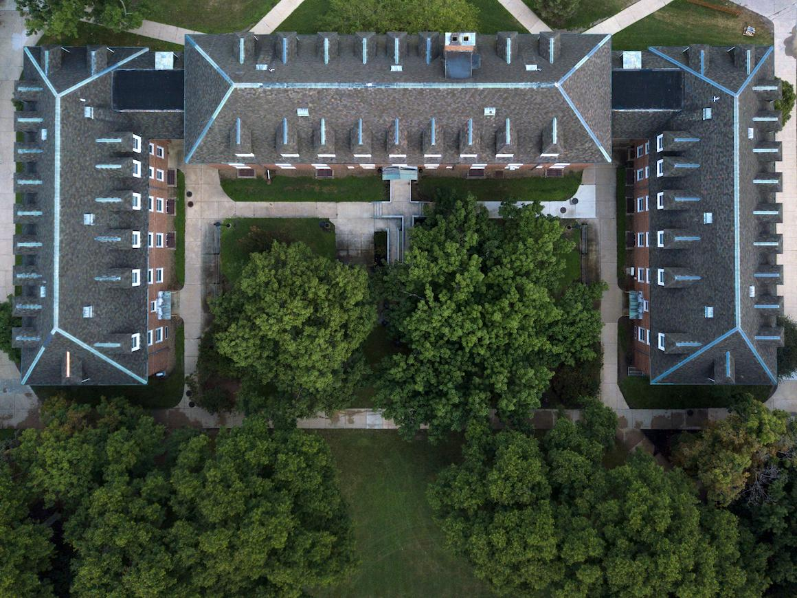 aerial view of a three story residence hall.