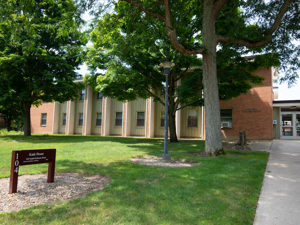 grassy area leading to the two story brick residence hall.