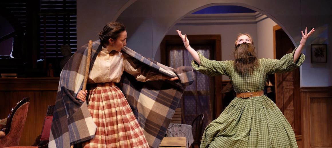Two women in a play.