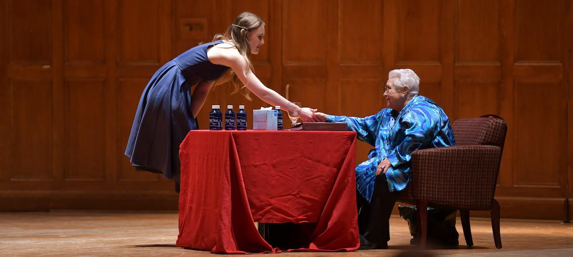 A student shakes Marilyn Horne's hand.