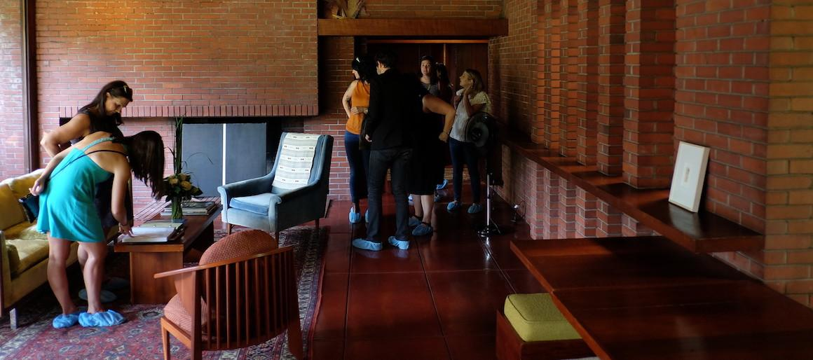 People walking around in the Frank lloyd Wright House.