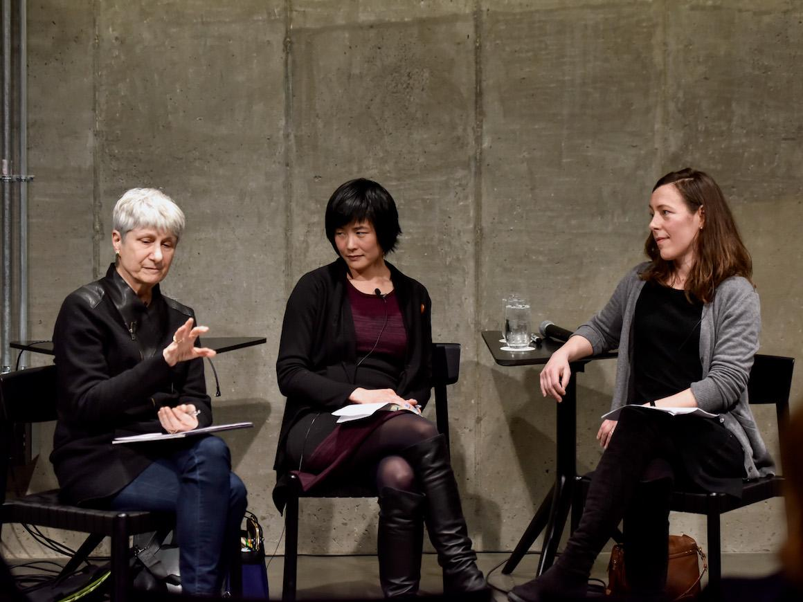 three women professors on stage discussing