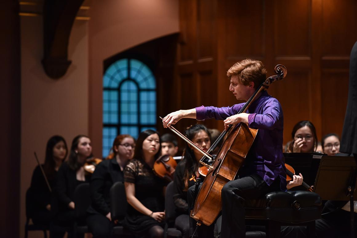 Cellist performs with orchestra
