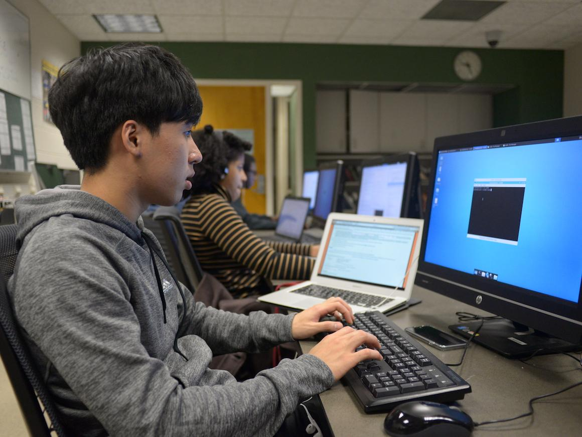 Photo of a student working on an assignment on the computer
