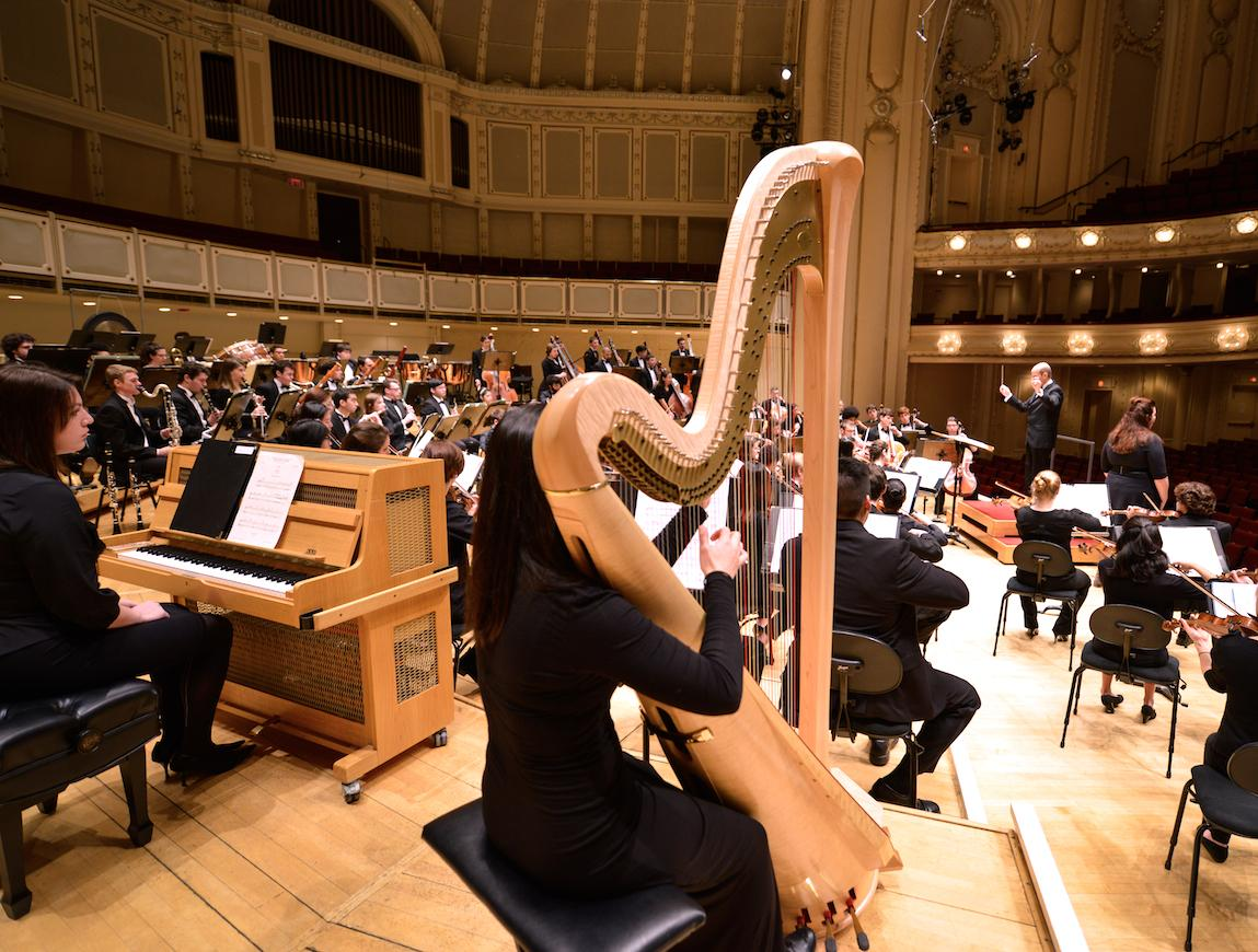 Conservatory student harpist plays with the Oberlin Orchestra during its Chicago concert tour
