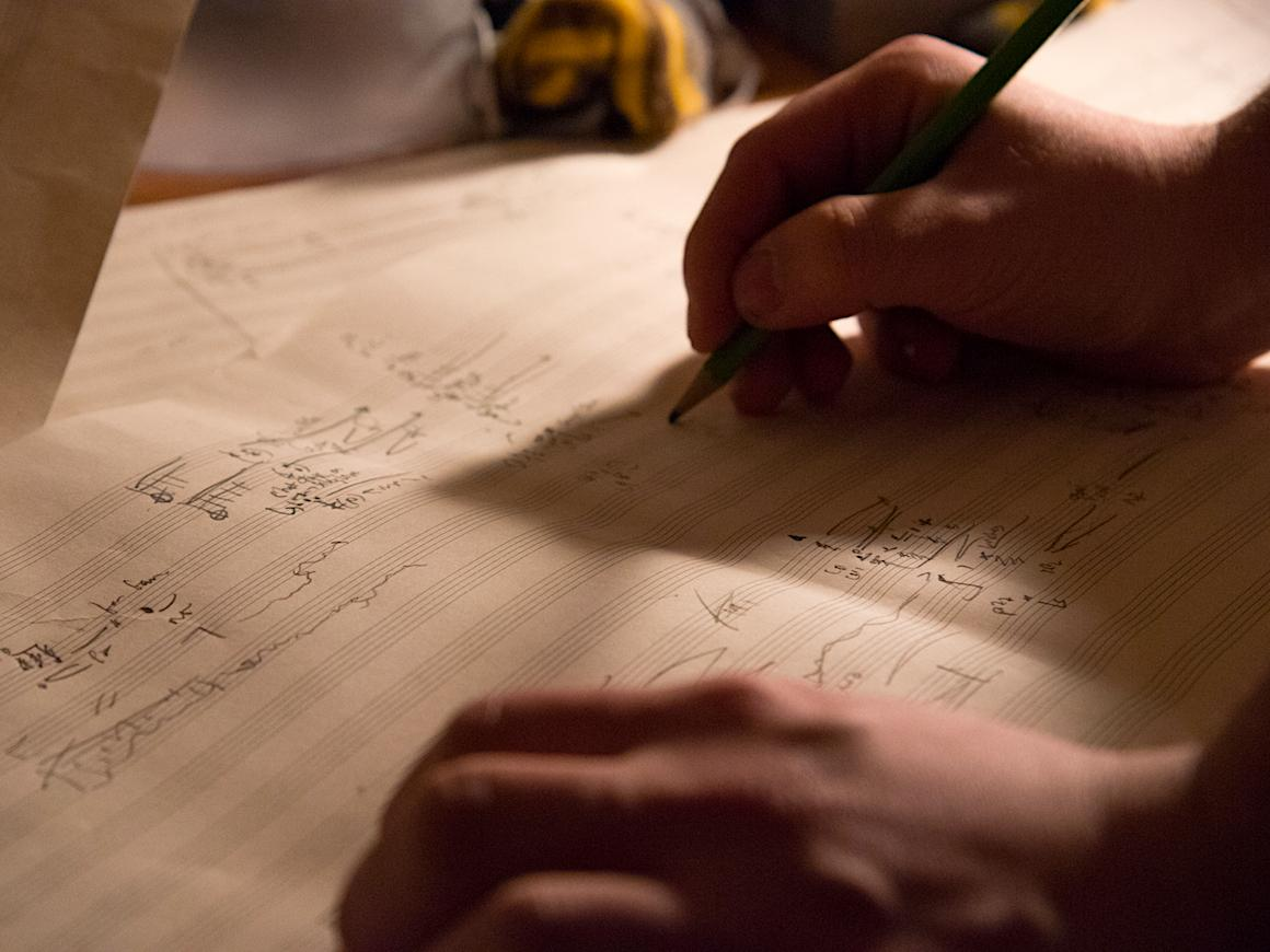 A student working on a musical composition