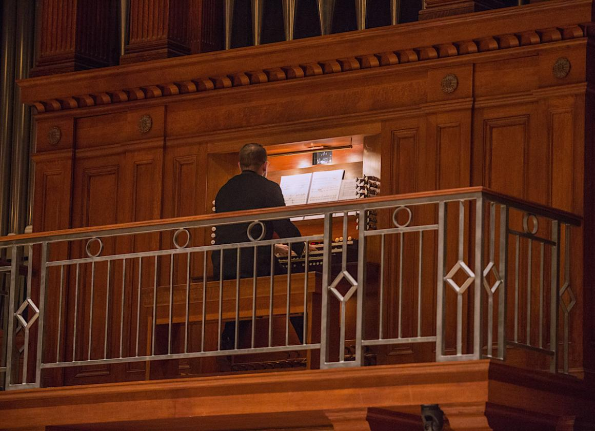 man playing organ