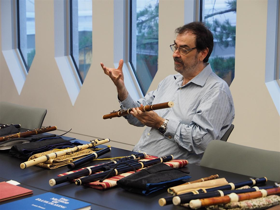 Professor Michael Lynn shows one of the instruments in his collection of historical instruments