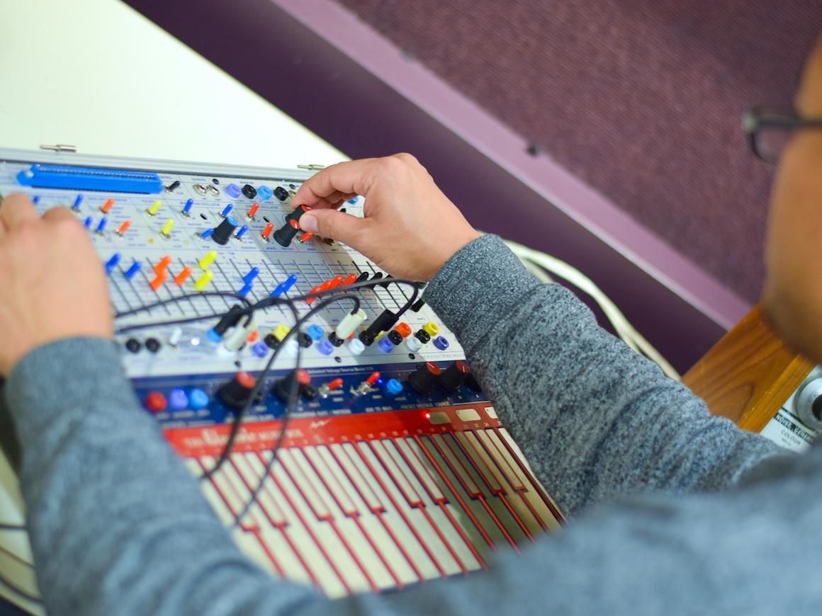 person at electroacustic keyboard